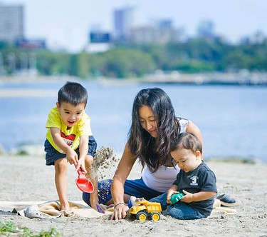 Jinne Kim, along with her kids Jace Goring, 3, and Max Goring, 11 months, enjoy some sand and sun in the western beaches in Toronto near the Humber River on Sept. 21, 2010. (ERNEST DOROSZUK, Toronto Sun)