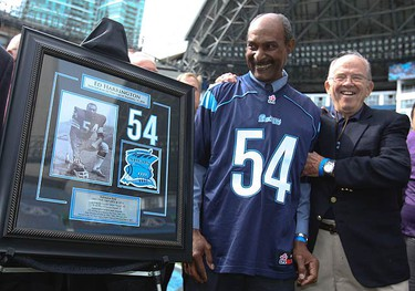 Argos all-time great Ed Harrington (54) is honoured at halftime with a plaque. The Argos went on to defeat the Blue Bombers 17-13 at the Rogers Centre on Sept. 19, 2010. (JACK BOLAND, Toronto Sun)