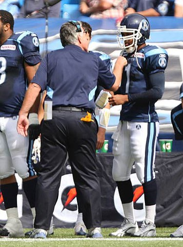 Argos head coach Jim BArker gives QB Cleo Lemon the business just before halftime about his plays. The Argos went on to defeat the Blue Bombers 17-13 at the Rogers Centre on Sept. 19, 2010. (JACK BOLAND, Toronto Sun)