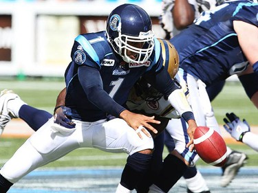 Bombers Odell Willis (L) ties up Argos Cleo Lemon causing him to fumble the ball in the fourth quarter of play. The Argos went on to defeat the Blue Bombers 17-13 at the Rogers Centre on Sept. 19, 2010. (JACK BOLAND, Toronto Sun)