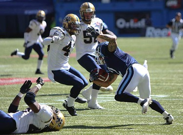 Argos kick returner Chad Owens dips and dives through the Blue Bombers line. The Argos went on to defeat the Blue Bombers 17-13 at the Rogers Centre on Sept. 19, 2010. (JACK BOLAND, Toronto Sun)