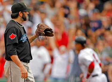 Toronto Blue Jays starting pitcher Shaun Marcum waits for a new ball after giving up a solo homerun to Boston Red Sox Victor Martinez during the fourth inning of their MLB American League baseball game at Fenway Park in Boston, Massachusetts on Sept. 19, 2010. (REUTERS)