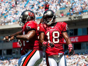 Tampa Bay Buccaneers running back Earnest Graham (R) celebrates a touchdown with wide receiver Sammie Stroughter (18) during the first half of their NFL football game against the Carolina Panthers in Charlotte, North Carolina, on Sept. 19, 2010. (REUTERS)