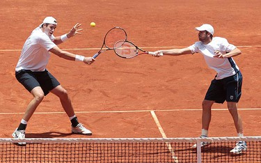 John Isner (L) and Mardy Fish of U.S. return the ball to Carlos Salamanca and Robert Farah of Colombia during their Davis Cup world cup playoffs doubles match in Bogota on Sept. 18, 2010. (REUTERS)