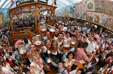People wearing traditional Bavarian clothes toast with beer during the opening of the 177th Oktoberfest in Munich on Sept. 18, 2010. Millions of beer drinkers from around the world will come to the Bavarian capital over the next two weeks for the world's biggest and most famous beer festival.  (REUTERS)