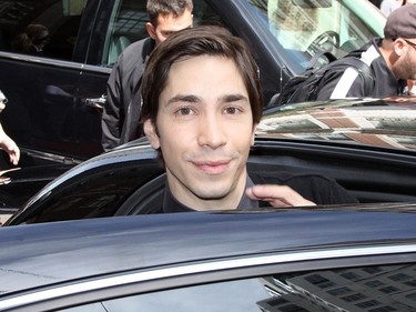 Justin Long leaving the Windsor Arms Hotel in Yorkville after doing a press conference for 'The Conspirator' during the Toronto International Film Festival. (John White, QMI Agency)