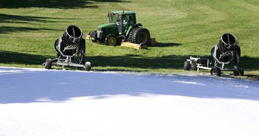 A Snow Valley Ski Club grounds crew member cuts the grass around some fresh blown snow in Edmonton on Friday September 17, 2010. The Snow Valley Ski Club grounds crew took the cold weather to run some of the snow making machines as they prepare the hill for the upcoming season.   (TOM BRAID/EDMONTON SUN)