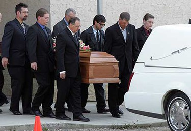 Oct. 3, 2008: Pallbearers leave with the casket of Emily Stauffer at the end of her funeral in Edson, Alberta. ((David Bloom/Sun Media))