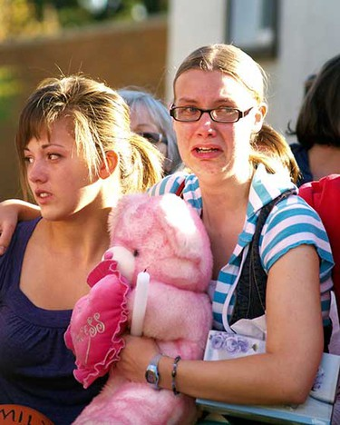 Sept. 29, 2008: Young women show their grief during a memorial service for Emily Stauffer. About 100 people attended at the Edson Baptist Church. (Michelle Thompson/Sun Media)