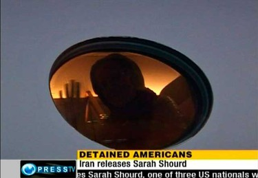 U.S. citizen Sarah Shourd waves from inside a plane at Tehran's Mehrabad Airport on Sept. 14, 2010. Shourd, one of three Americans held in Iran for more than a year on suspicion of spying, left the country on Tuesday after she was released on bail, a diplomatic source said. (REUTERS)