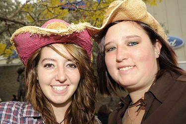 Nichole Sasewich and Vanessa Sasewich wait outside Rexall Place Sunday afternoon for the Canadian Country Music Association Awards. (Candice Ward/Edmonton Sun)