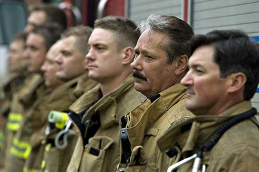 Firefighters and families attend a memorial for firefighters at Firefighter Memorial Park in Old Strathcona in this file photo. (EDMONTON SUN)