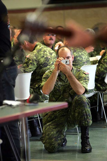 A soldier takes pictures as Canadian country singer and songwriter Dean Brody performs for the military personnel at the Steele Barracks in CFB Edmonton on September 9, 2010. Brody gave a free performance because of his respect for the soldiers. (PERRY MAH/EDMONTON SUN)