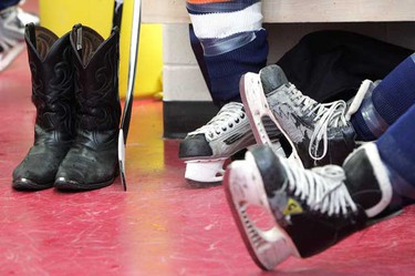 Canadian country music artists and former NHL players wait in the dressing room prior to taking part in The Pics and Sticks charity hockey game.(DAVID BLOOM/EDMONTON SUN  QMI AGENCY)