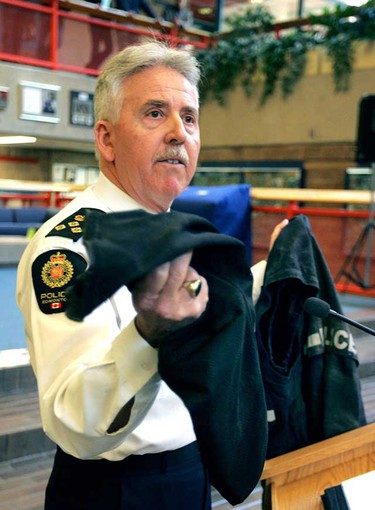 Edmonton Police Chief Mike Boyd holds the ripped jacket of a police officer Dec. 5, 2008, as he addresses the media about attacks on police officers.   The jacket belongs to a police member who was swarmed during a bar fight. (EDMONTON SUN FILE)