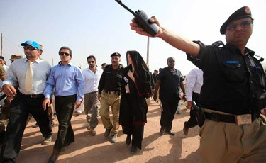 Actress Angelina Jolie (C) arrives at the Jalozai flood victim relief camp during her visit to flood affected areas and relief camps supported by the UNHCR (United Nations High Commissioner for Refugees), in Pakistan's northwest Khyber-Pakhtunkhwa Province, Sept. 7, 2010. Jolie called on Tuesday for constant and long-term  assistance for Pakistan to help it cope with its worst ever floods that have wreaked havoc on the impoverished country. (REUTERS)