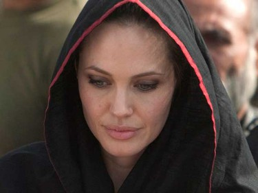 Actress Angelina Jolie arrives at the Jalozai flood victim relief camp during her visit to flood affected areas and relief camps supported by the UNHCR (United Nations High Commissioner for Refugees), in Pakistan's northwest Khyber-Pakhtunkhwa Province, Sept. 7, 2010. Jolie called on Tuesday for constant and long-term  assistance for Pakistan to help it cope with its worst ever floods that have wreaked havoc on the impoverished country. (REUTERS)