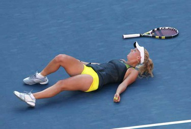 Caroline Wozniacki of Denmark lies on the court after falling during her match against Maria Sharapova of Russia at the U.S. Open tennis tournament in New York,  Sept. 6, 2010.  (REUTERS)