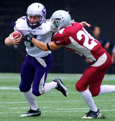 Ottawa Gee-Gees Chris Daly pursues Western Mustangs QB Donnie Marshall during the Gee-Gees home opener at Frank Clair Stadium. September 6,2010 (Errol McGihon/The Ottawa Sun)