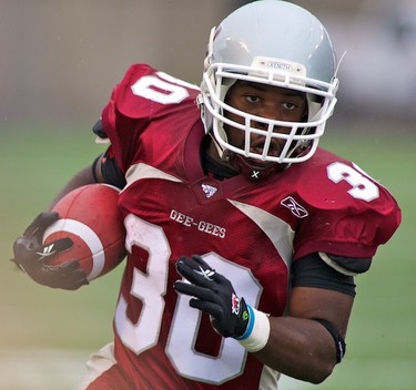 Ottawa Gee-Gees RB Franck Hgandui runs the ball against the Western Mustangs during the Gee-Gees home opener at Frank Clair Stadium. September 6,2010 (Errol McGihon/The Ottawa Sun)