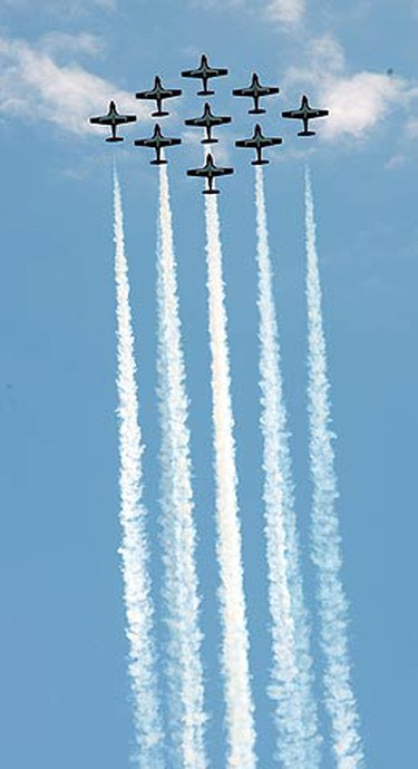 The Canadian Snowbirds perform on their fourth anniversary at the Canadian International Air Show at the Canadian National Exhibition in Toronto on Sept. 5, 2010. (CRAIG ROBERTSON, Toronto Sun)