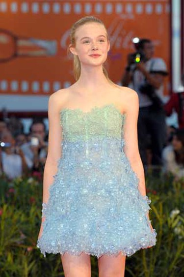 """Actress Elle Fanning, Dakota Fanning's sister, poses  during the """"Somewhere"""" red carpet event at the 67th Venice Film Festival Sept. 3, 2010.  (WENN.com)"""