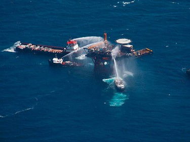 Boats spray water to extinguish a fire on an oil and gas platform operated by Mariner Energy off the Louisiana coast Sept. 2, 2010. The oil and gas platform burst into flames in the Gulf of Mexico on Thursday, but the crew of 13 escaped and there were no signs of an oil spill, the U.S. Coast Guard said.  (REUTERS)