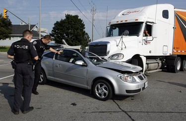 A female driver in her 30s was taken to hospital with minor injuries after colliding with a transport truck in the intersection of Innes Rd. and Bantree Rd. during rush hour Monday, August 30, 2010. The driver and occupant of the transport truck were uninjured. (Darren Brown/Ottawa Sun)
