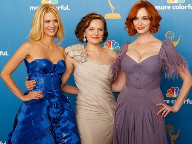 Actresses January Jones (from left), Elisabeth Moss and Christina Hendricks of Mad Men pose backstage after the show won for outstanding drama series at the 62nd annual Primetime Emmy Awards in Los Angeles on Sunday, Aug. 29. (REUTERS/Danny Moloshok)