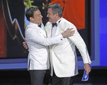 Host Jimmy Fallon (L) and actor Tom Selleck embrace before Selleck is presented an award at the 62nd annual Primetime Emmy Awards in Los Angeles, California, August 29, 2010.   REUTERS/Lucy Nicholson