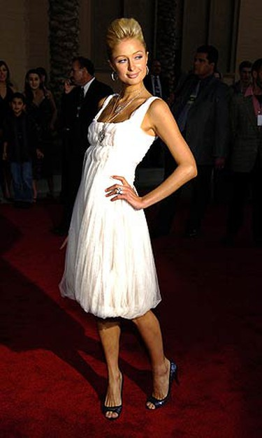 In this November 2005 file photo, Paris Hilton poses as she arrives for the American Music Awards at the Shrine Auditorium in Los Angeles. (REUTERS)
