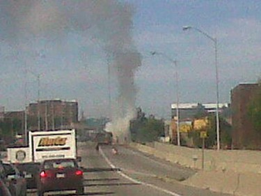 A car fire along the westbound Hwy. 417 snarled traffic briefly on Friday morning. The blaze was called in to city fire crews at about 10:30 a.m., in the westbound lanes near Metcalfe St. It was quickly doused, and there were no injuries. Witness Sashien Godakandae captured these images on his BlackBerry and submitted them to the Sun. Although traffic was backed up during the incident, flows through the area have since returned to normal.