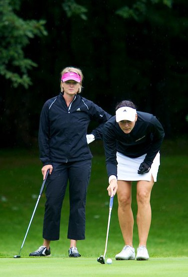 Louise Chevrier (L) and playing partner Celina Stipanic line up a putt during play on Championship Saturday of the Ottawa Sun Scramble at the Outaouais Golf Club in Rockland. August 21,2010 (Errol McGihon/The Ottawa Sun)