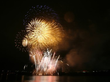 Fireworks light up the sky above Lac Leamy Saturday evening as teams competed in the grande finale of the Sound of Light competition. In the end, Germany edged out crowd favourite China. DOUG HEMPSTEAD/Ottawa Sun