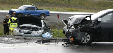 Both westbound lanes on Hwy. 7 were closed at Jinkinson Rd. after a two-car crash that left one person dead and another was airlifted to hospital on Aug. 21, 2010. DOUG HEMPSTEAD/Ottawa Sun