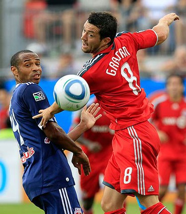 New York Red Bulls forward Thierry Henry and Toronto FC defender Dan Gargan (R) watch a ball get past them during the first half of their MLS soccer game in Toronto August 21, 2010.  (REUTERS)