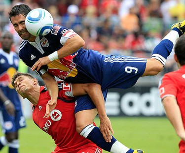 Toronto FC defender Adrian Cann (L) collides with New York Red Bulls forward Juan Pablo Angel during their MLS soccer game in Toronto August 21, 2010.  (REUTERS)