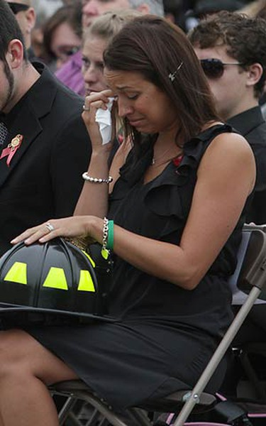 Pamela Alspach, daughter of Capt. Patrick L. Glendingning, reacts after a firefighter gives her the helmet of her late father at the 125th Canadian Firefighters Annual Memorial Ceremony in Ottawa on Sept. 12, 2010. (CHRIS ROUSSAKIS, QMI Agency)