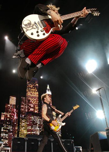 """Lead Singer Billie Joe Armstrong goes airborne during their second song """"Know Your Enemy."""" (JACK BOLAND, Toronto Sun)"""