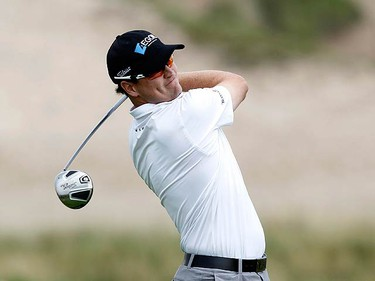 Zach Johnson of the U.S. tees off on the second hole during the second round of the 92nd PGA Golf Championship at Whistling Straits, in Kohler, Wisconsin, August 13, 2010. (REUTERS)