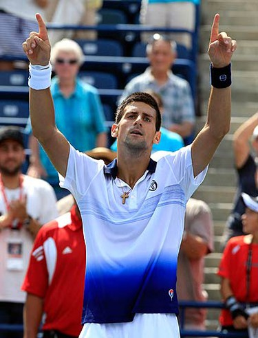 Novak Djokovic of Serbia celebrates his win against Julien Benneteau of France during the Rogers Cup tennis tournament in Toronto August 11, 2010. (REUTERS)