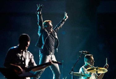 Lead singer Bono of Irish rock band U2 performs during their 360 Degree Tour at the Commerzbank Arena in Frankfurt, August 10, 2010.  (REUTERS)