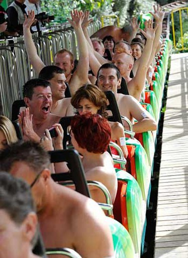 This is the moment more than 100 thrill-seekers dared to bare - by enjoying a record-breaking nude rollercoaster ride.  Fun-lovers peeled off their clothes and climbed aboard the Green Scream ride in Southend, Essex, on Sunday August 8, 2010 to smash the previous record. (Jo Curtis/WENN.com)
