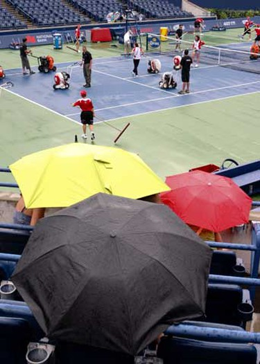 Rogers Cup grounds crew dry off Centre Court as the first rain delay of the day. (Jack Boland/QMI Agency)