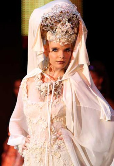 A model presents a creation by Palestinian designer Hindi Mahdi during the Islamic Fashion Festival in Monte Carlo August 9, 2010. (REUTERS)