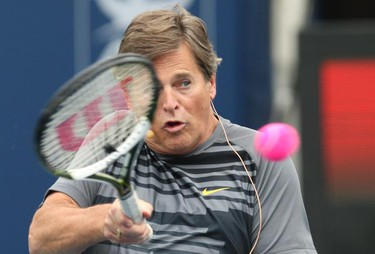 CityTV anchor Gord Martineau on Centre Court at the Celebrity Tennis kick-off at the Rexall Tennis Centre at York University in Toronto on Aug. 7, 2010.  (STAN BEHAL, Toronto Sun)