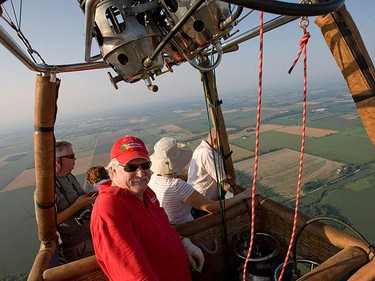 Toronto Sun photographer Dave Thomas took to the sky in a hot air balloon north of the GTA. Dave lifted off with SundanceBalloons.com aboard the second largest balloon in Canada and soared well over 2,500 ft. in the air while hovering over fields and forests. (DAVE THOMAS, Toronto Sun)