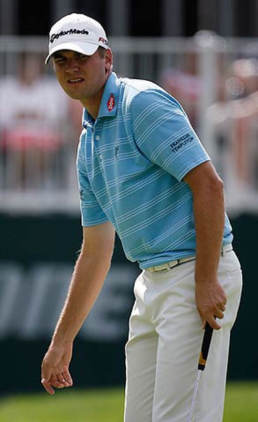 Sean O'Hair of the U.S. watches his putt roll on the 18th green during the third round of the WGC Bridgestone Invitational at Firestone Country Club in Akron, Ohio, August 7, 2010. (REUTERS)