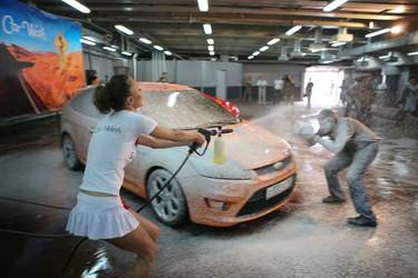 Models got wet and wild at a car wash in St. Petersburg, Russia.   The lovely ladies got active at the Alarm Sexy Car Wash and helped to lather up the cars as they strutted their stuff. (WENN.com)