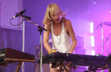 Indie rockers Metric played a 45-minute free concert at Union Station Plaza to more than 3,000 adoring fans in Toronto on Aug. 4. (JACK BOLAND, Toronto Sun)